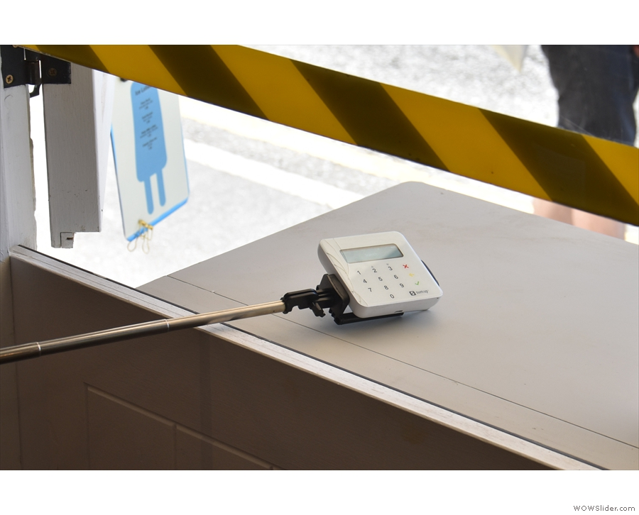 ... desk, set back from the window. Payment is card only, the card reader on a selfie-stick.