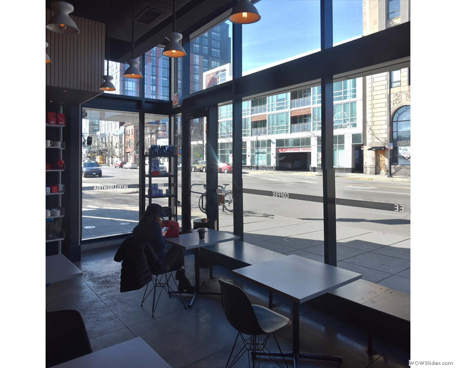 ... with three more two-person tables by a bench running along the windows at the front.
