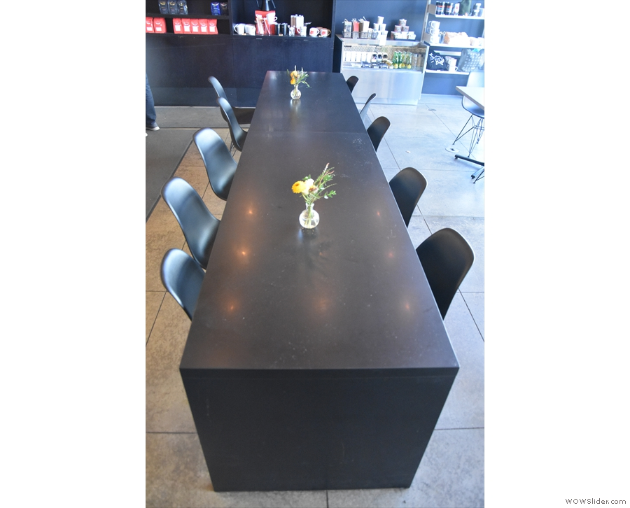 The bulk of the seating is in the middle, starting with this 10-person table by the counter.