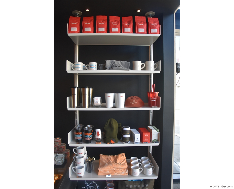 The next set of shelves, after the window, has mugs and other merchandising...