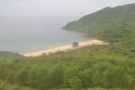As we approach the curve, you can see Bãi Chuối (Banana Beach) down below...