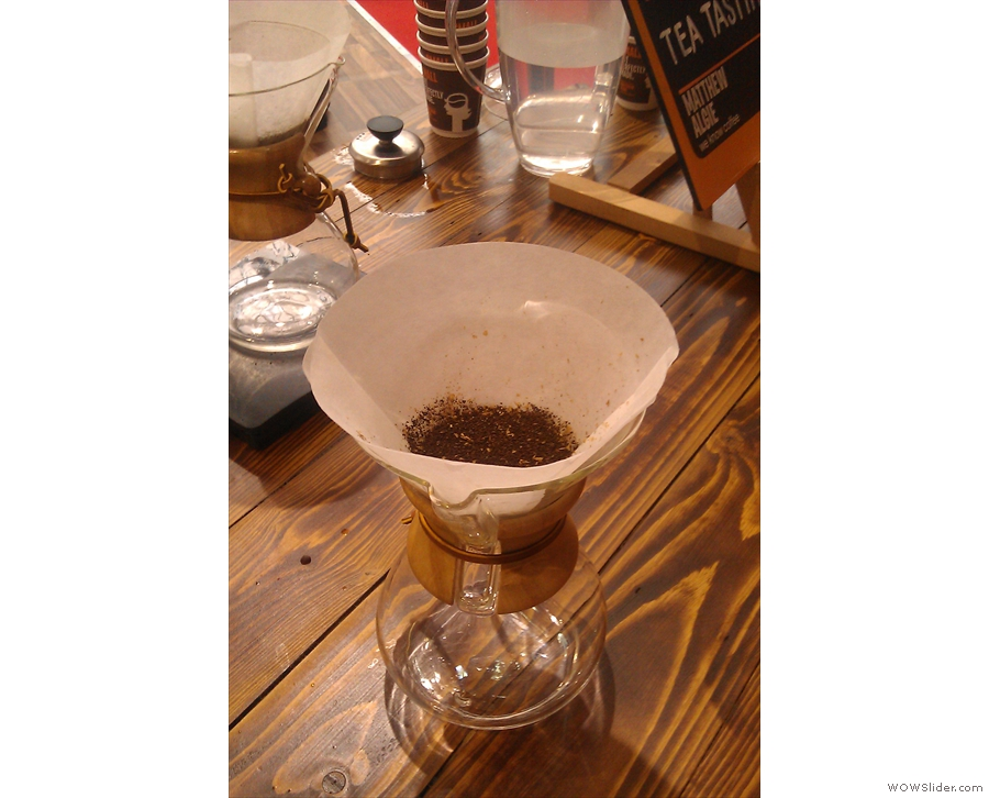 While the Chemex filter paper is much thicker, the grind is the same for both methods. As before, a precise amount of ground coffee is weighed out and put into the filter.