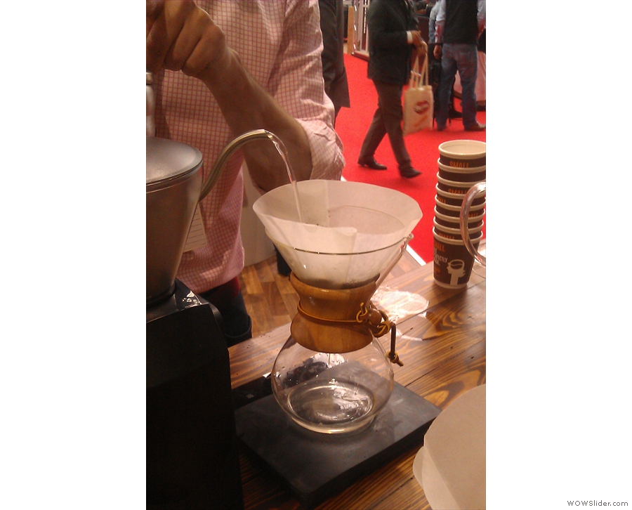 Unlike the pour-over, the water is weighed as it is poured to ensure a precise dose. However,  as before, a small amount is poured in first to allow the grounds to bloom.
