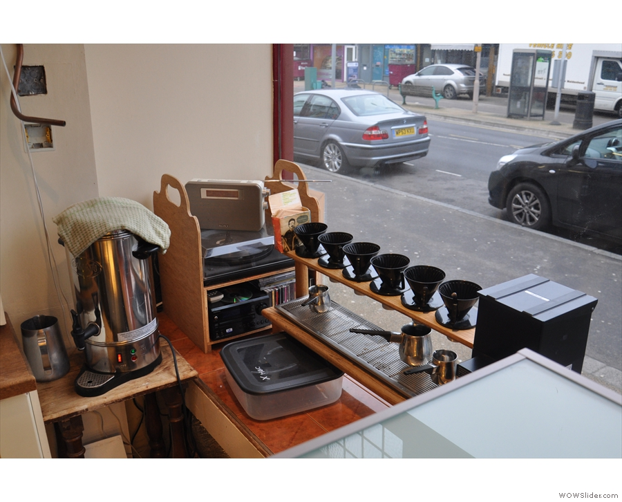 The row of pour-over filter cones in the window.