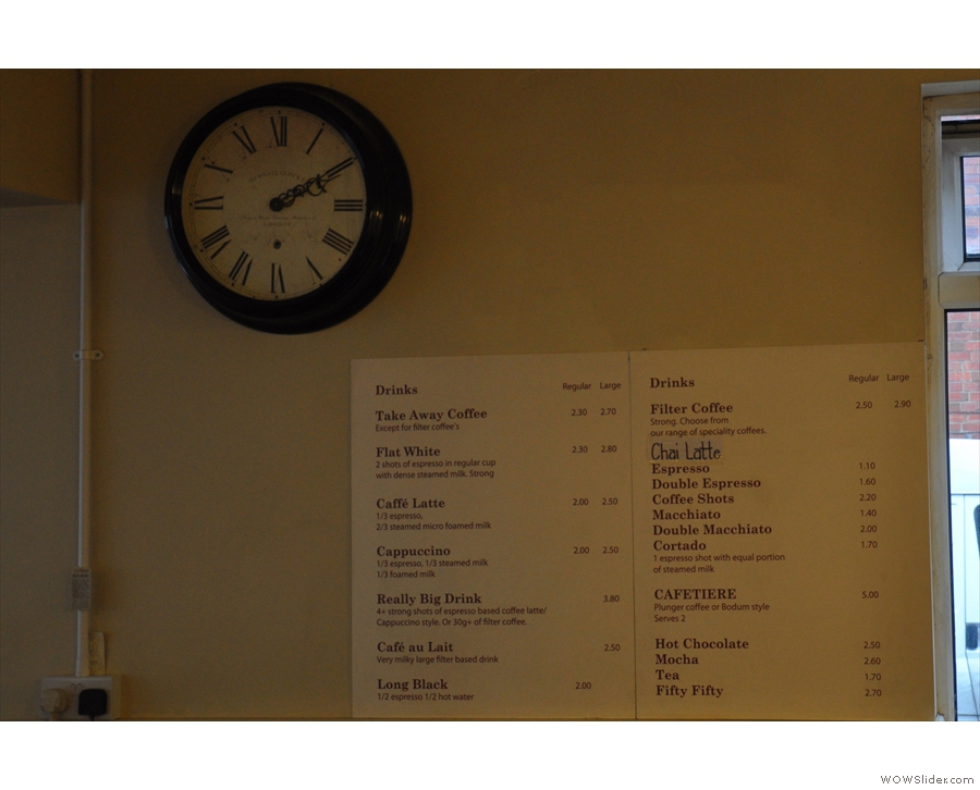 The interestingly located menu on the wall opposite the counter.