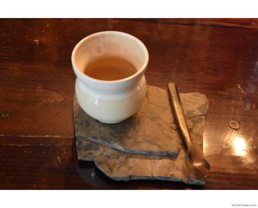 A single-origin espresso served in an hour-glass shaped cup at Discourse Coffee...
