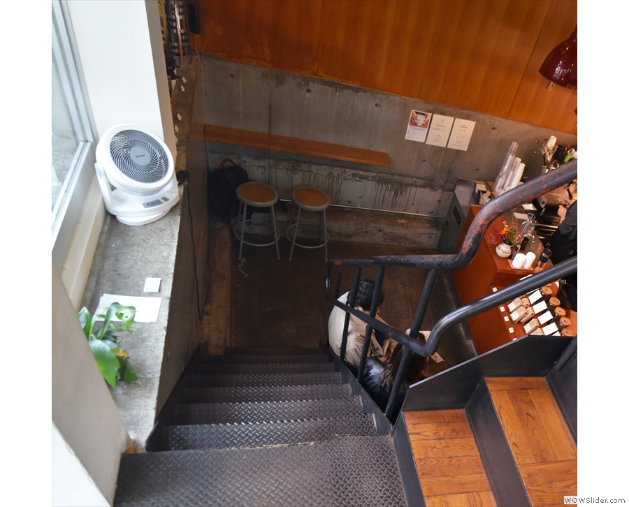 Stairs lead down to the left from the small landing immediately inside the door.