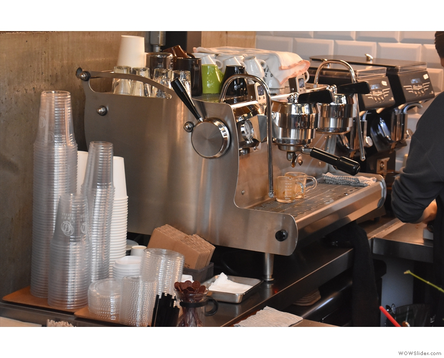 Finally, the Synesso espresso machine is off to the left, against the wall.