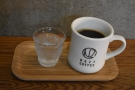 ... served in a diner mug on a tray with a glass of chilled water on the side.