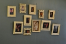 A wall full of pictures. I'm not sure who these are by.