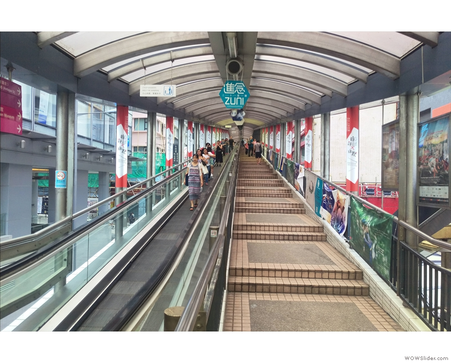 ... famous Mid-Levels escalator, the longest outdoor escalator in the world.