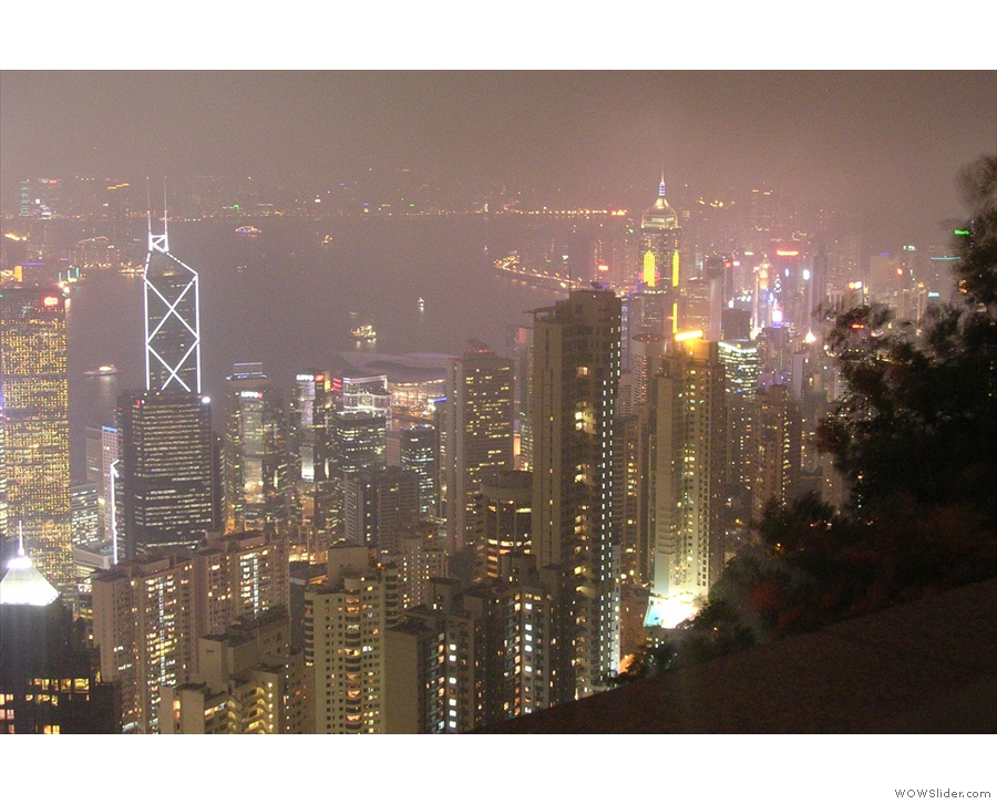 ... with the view further east along the shore towards Wan Chai and Causeway Bay.