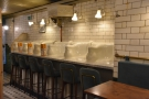 A view of the urinal seating from the tables at the back.