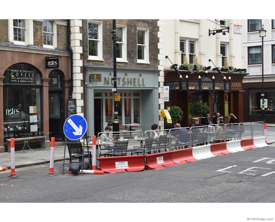 The barriers, by the way, close off the left-hand lane of the street to create an outdoor...