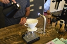 I decided to have a pour-over. Here, Yatish rinses out the filter paper of the V60.