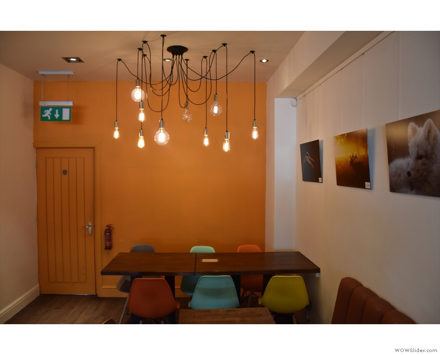 ... is a six-person table against the back wall.