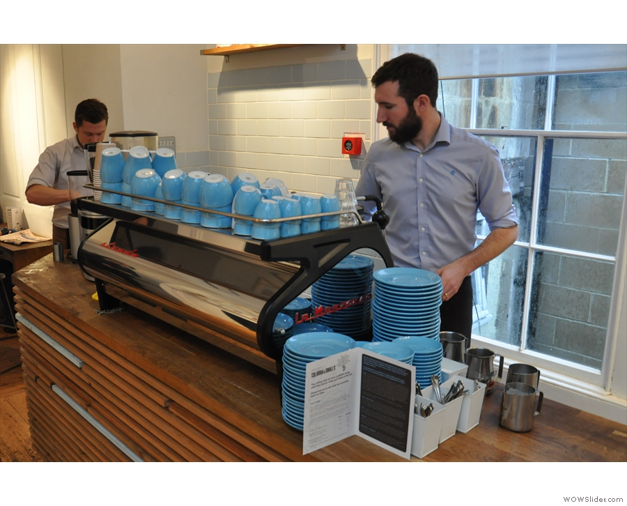 Next, a shiny La Marzocco Strada, complete with neat blue cups.