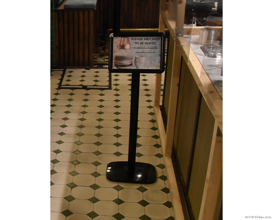 ... and signs asking you to wait to be seated at Attendant.