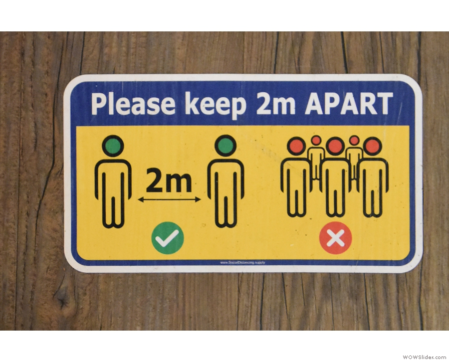 There are plenty of signs on floors as well, reminding you to keep your distance...