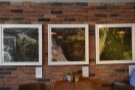 I liked the pictures hanging on the exposed brick wall behind the tables...