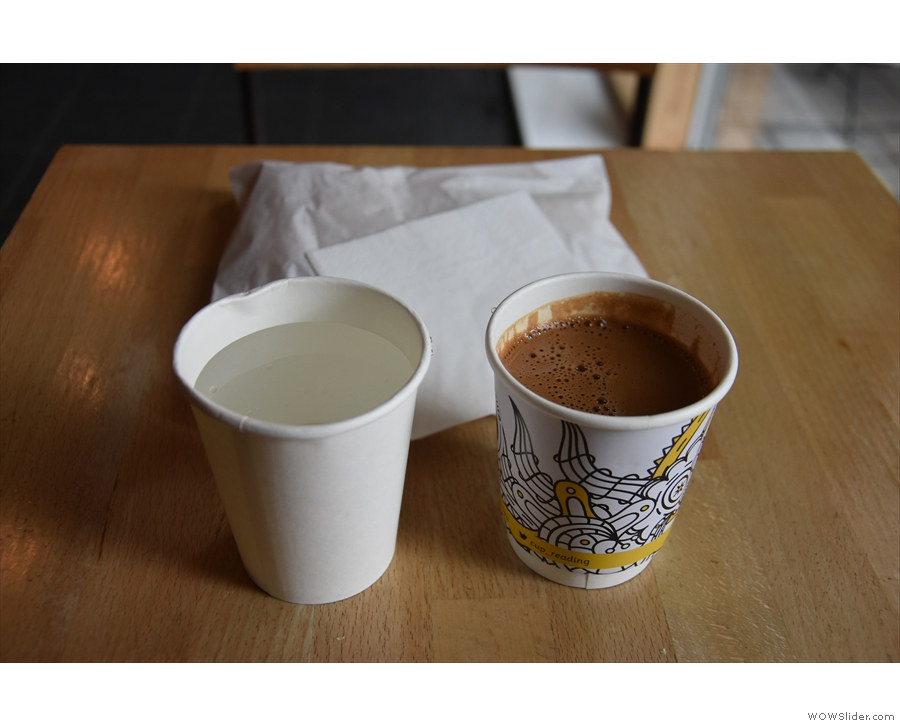 I tried the Greek coffee, served in a takeaway cup, which came with a cup of water.