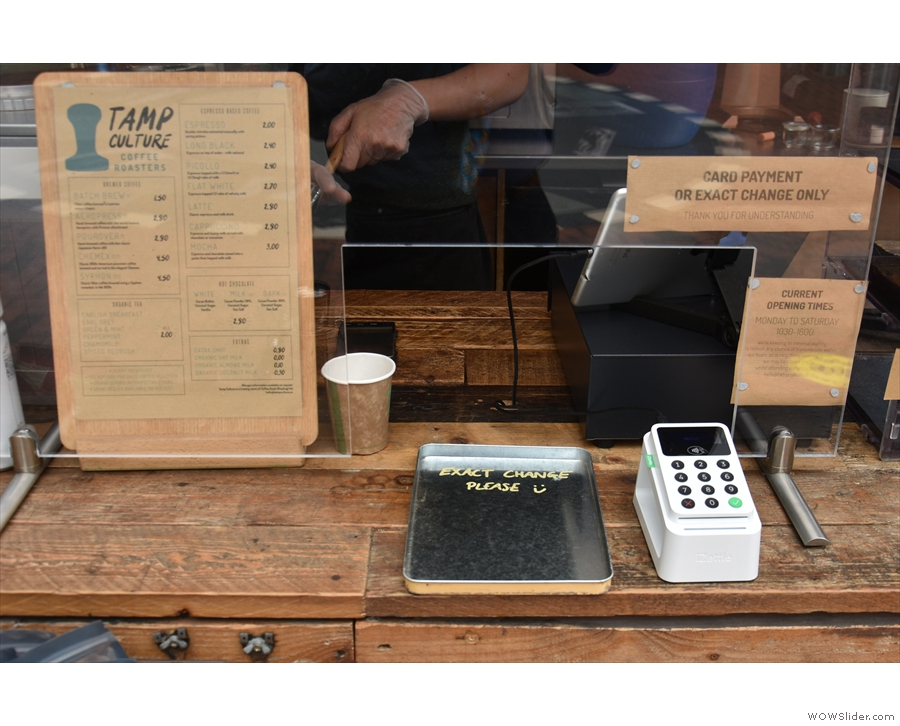 There's a small gap in the Perspex screen if paying by cash (exact change only)...