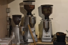 ... while behind them, against the wall, are three grinders with the other espresso options.