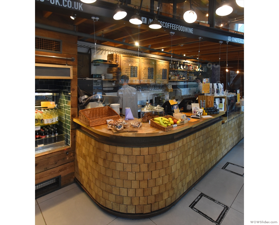 ... while the gorgeous counter is on the left, with its wood-brick construction.