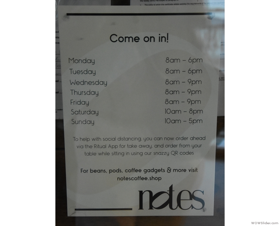 The (revised) opening times are displayed by the door...