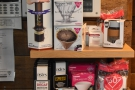 There's more retail, includng coffee making equipment, on a shelf by the door.