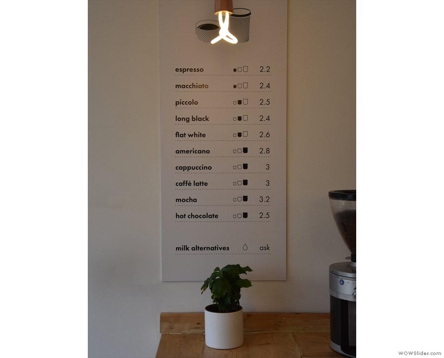 ... where you'll find the menu on the wall at the back...