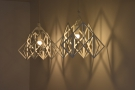 Meanwhile, these open lattice lamp shades throw some wonderful shadows on the wall.
