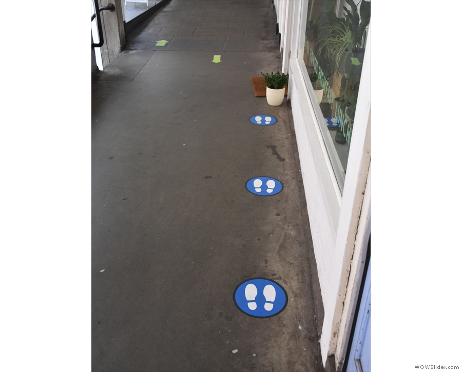 Meanwhile, down the front of The Flower Cup, footsteps show you where to queue.
