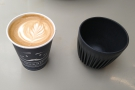 To business. Gourmet Coffee Bar isn't accepting customer's cups at the moment, so my...