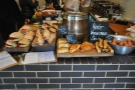 The counter is front-loaded with savoury things rather than cake...