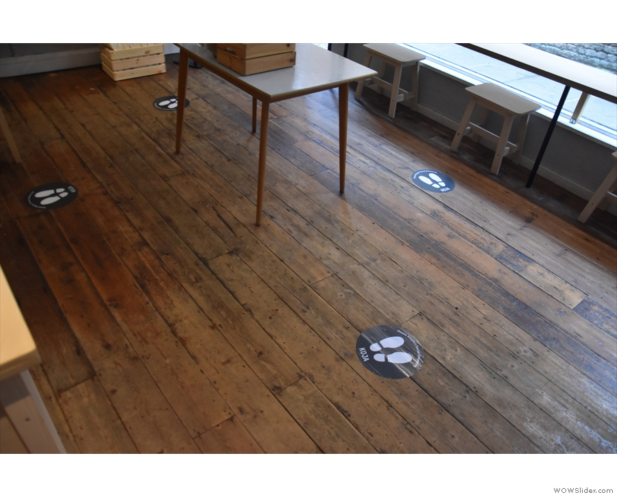Once you've got your coffee, the stickers on the floor lead you out the other way...