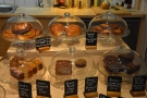 ... with its tempting array of cakes and sandwiches on the right...