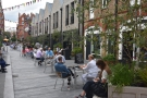 Since COVID-19, the street has been filled with tables, all of which were taken...