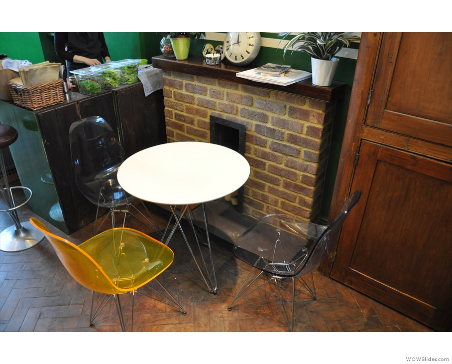 There's this round table by the (disused) fireplace...