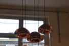 I liked the bronze lampshades hanging from the ceiling.