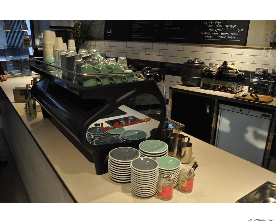 The espresso machine, a La Marzocco Strada, is right in the middle...