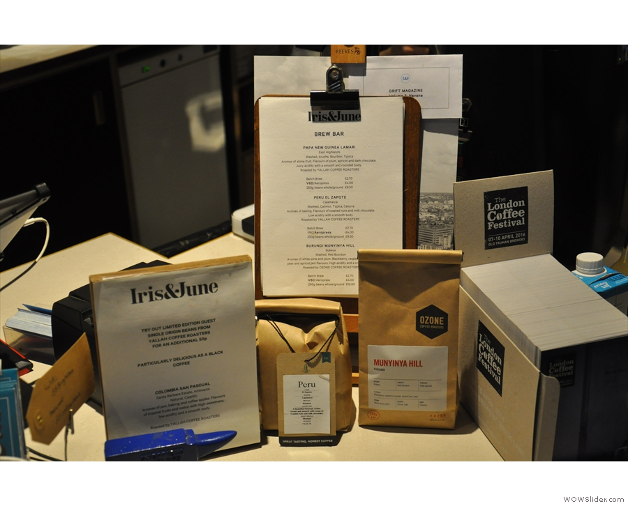 The various coffees on offer are displayed by the till at the other end of the counter.