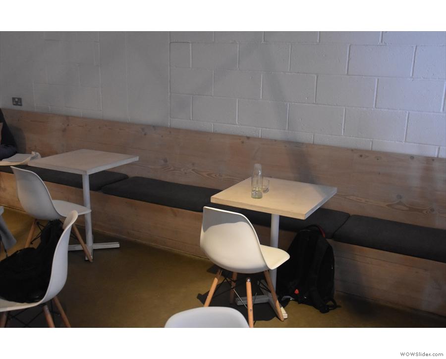 ... six two-person tables running along this bench, but they've been reduced to four.