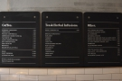 The drinks menus are still on the wall behind the counter...