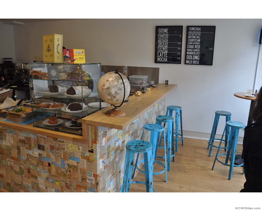 There used to be seating at the front too, including bar stools at the counter...