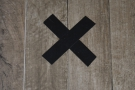 X marks the spot! Buried treasure, perhaps? Or maybe where you have to stand to order.