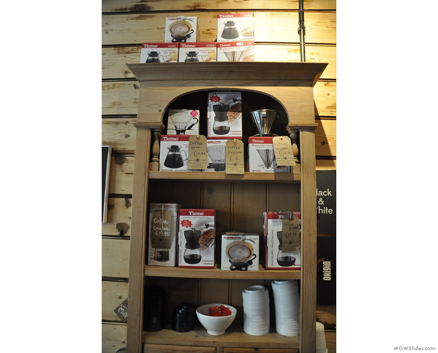 The shelf of coffee-making equipment.