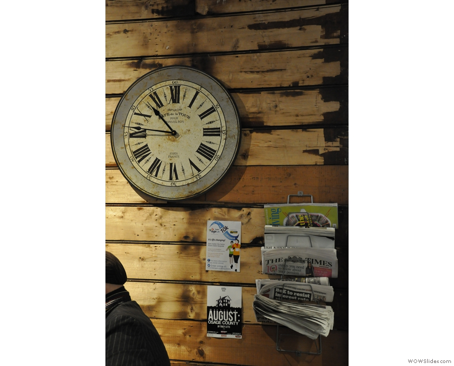 The clock on the wall, plus a paper rack, which was very popular while I was there.