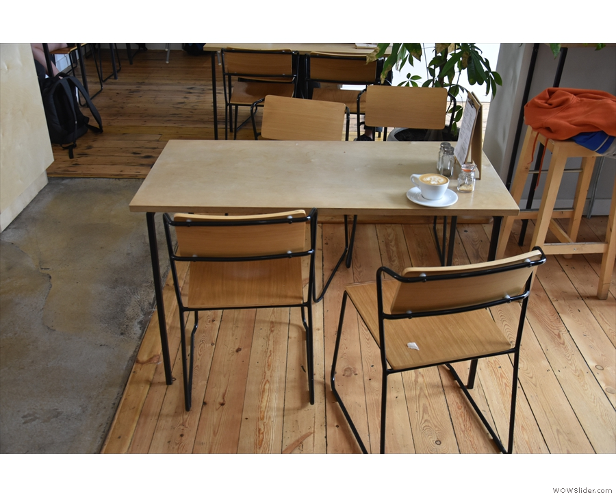 ... although this table, in the middle, is new. There's more seating on the left...