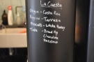 These days it holds the espresso grinders, details of the beans chalked on the front.